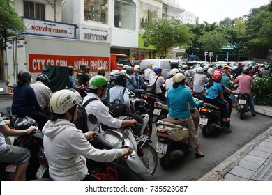HOCHIMINH, VIETNAM - 4 Oct,2017 : A lot of motorcyclists and vehicles drive along BEN TAN Street during rush hours. The main means of transport in Vietnam is motorcycle.