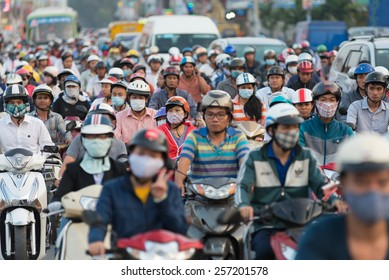 HOCHIMINH, VIETNAM - FEB 9, 2015: A lot of motorcyclists and vehicles drive along Quang Trung Street during rush hours. The main means of transport in Vietnam is motorcycle.