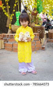 HoChiMinh, Vietnam – February 9 2015: The baby girl goes to the park with his mother, in HoChiMinh, Vietnam. Teddy bear and baby girl