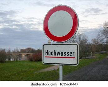 Hochwasser Flood Sign with caption Flood and passage forbidden