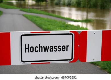 Hochwasser (German for high water) flood barrier sign due to flooding in Germany