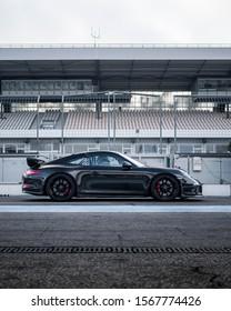 Hockenheim Germany - 11 16 2019: Porsche 911 GT3 on a racetrack in the pit lane. Shot from the side.