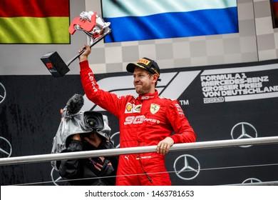 Hockenheim, Germany. 25-28/07/2019. Grand Prix of Germany. F1 World Championship 2019. Sebastian Vettel, Ferrari, celebrating second place on the podium.
