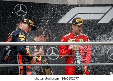 Hockenheim, Germany. 25-28/07/2019. Grand Prix of Germany. F1 World Championship 2019. Max Verstappen, Red Bull, and Sebastian Vettel, Ferrari, celebrating on the podium.