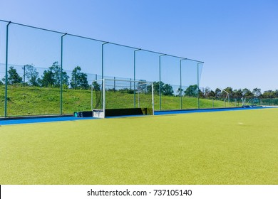 Hockey Astro Field Goals Blue Hockey field goals nets astro turf surface field outdoors blue sky countryside.