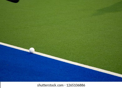 Hockey Ball on sideline waiting to be put back into play