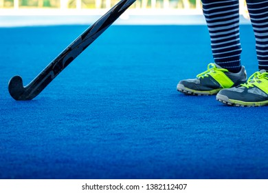 Hockey being played on astro turf artificial grass hockey field