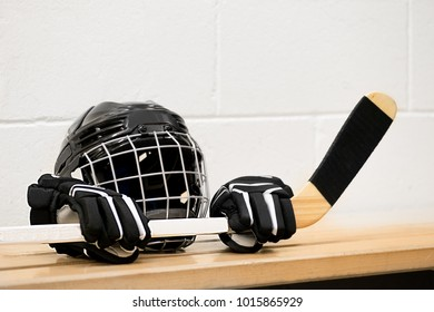 Hockey equipment on the bench: Helmet, gloves and stick