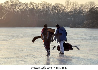 Hockey go away after a hockey game. Hockey players go on the frozen river after a game of hockey outdoor.Winter playing, fun, snow.