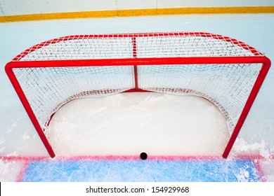 Hockey goal with puck on red line. View from above