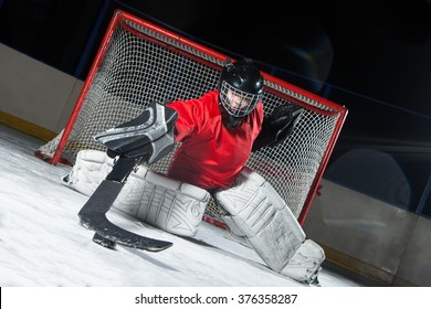 Hockey goalie blocking a puck with stick