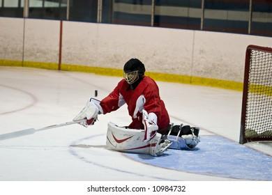Hockey goalie making a save during a game