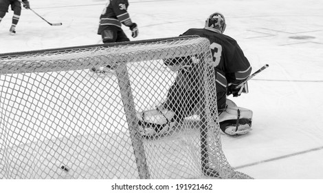 hockey goals, coaching the goalkeeper, black and white photo