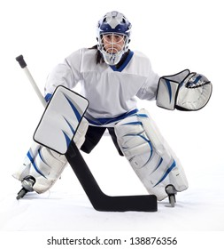 Hockey goaltender in ready stance on a white background