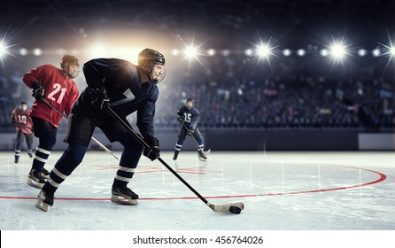 Hockey match at rink   . Mixed media