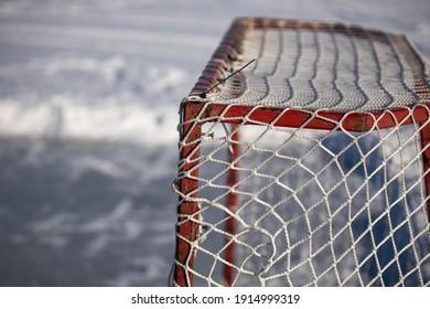 Hockey Net Goal On Outdoor Rink Frozen Lake In Canada