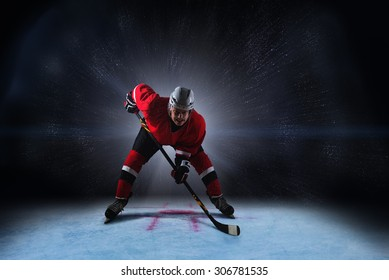 Hockey player above face off spot