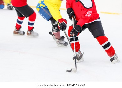 Hockey player counterattack in hockey game. Winter sport background