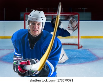 Hockey player defending his goalie against attack