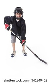 A hockey player with equipment over a white background