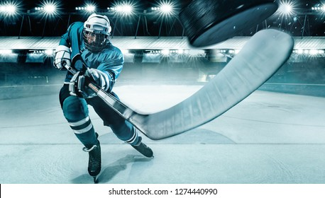 Hockey player in the mask on stadium.