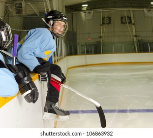 A Hockey Player on the Bench at the Rink is Ready to Jump on the Ice and Play