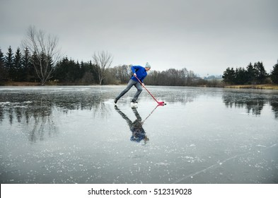 Hockey player on rural natural ice - sport active photo