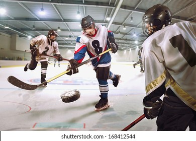 Hockey player shoots the puck and attacks
