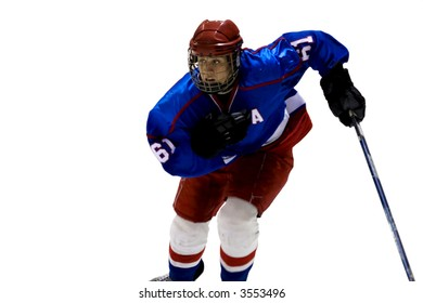 Hockey player is skating into the photograph.  Wearing a royal blue jersey.  Hockey player is isolated.