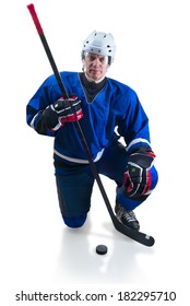Hockey player with stick stand on knee position. On the white background with shadow