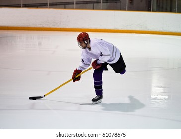 Hockey player taking a shot on net