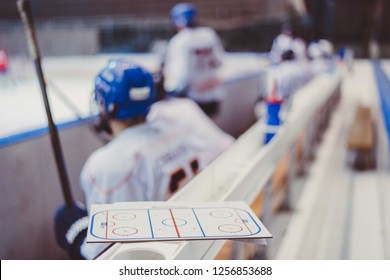 hockey players sit on the bench in the stadium