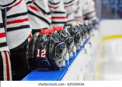 Hockey Players stand at Bench during National Anthem