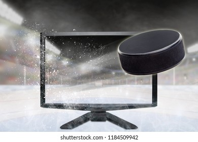 Hockey puck flying out of shattering TV screen in stadium with copy space. Concept of realistic 3D or 4D sports TV, virtual reality VR or computer gaming.