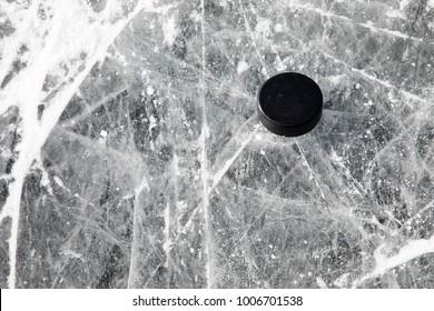 Hockey puck on a frozen pond