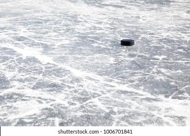 Hockey puck on a frozen pond in Colorado