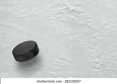 Hockey puck on the ice arena. Texture, background