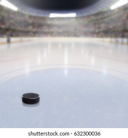 Hockey puck on ice in fictitious arena with fans in the stands and copy space. 3D rendering of hockey rink arena.
