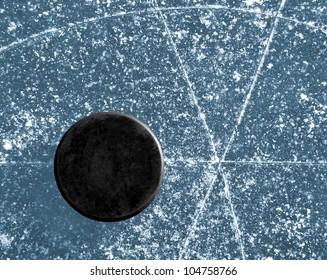 hockey puck on ice ring