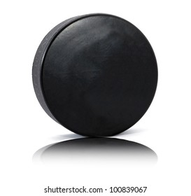 Hockey puck with reflection on white background