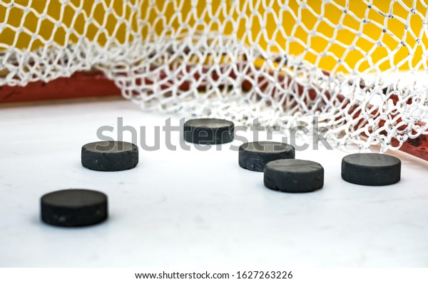 hockey pucks in the gate