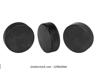 Hockey pucks, lined up in a row on a white background