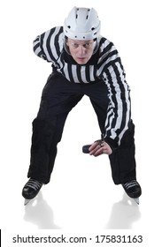 Hockey referee holding a puck in face off position. Front view. White background with shadow.