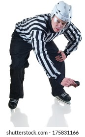 Hockey referee holding a puck in face off position. Side view. White Background with shadow.