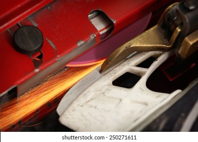 Hockey skate getting sharpened on a machine