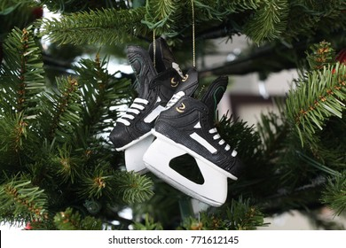 Hockey skates Christmas tree ornament on tree daytime