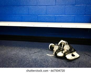 Hockey skates in locker room