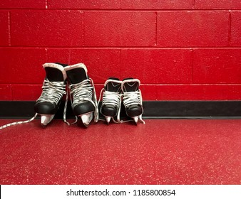 Hockey skates in locker room with red background and copy space