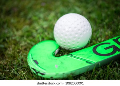 Hockey stick with ball on grass natural for sports clubs and teambuilding