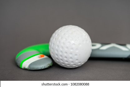 Hockey stick with ball on neutral background for sports clubs and teambuilding